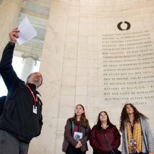 Program Instructor speaking with female students at the Thomas Jefferson Memorial in Washington, DC