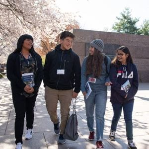 Latino students walking and talking on Congressional Hispanic Caucus Institute while at Franklin Delano Roosevelt Memorial in Washington, DC