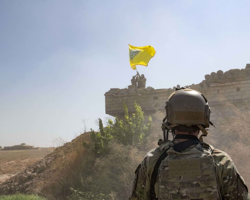 U.S. soldier facing ISIS fighters in Syria